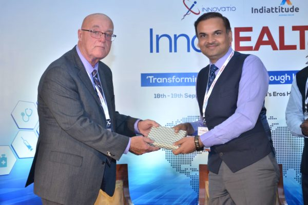 Dr Ronald Heslegrave presenting a memento to Dr V K Sharma at InnoHEALTH 2017