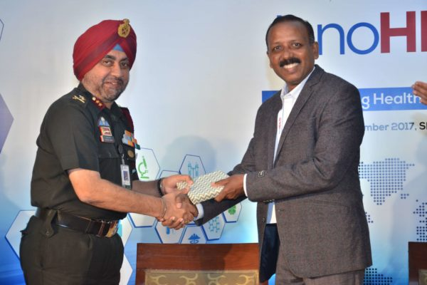 Maj Gen Jagtar Singh presenting a memento to Dr S Venkataramanaiah at InnoHEALTH 2017