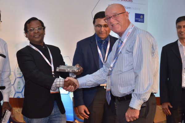 Ronald Heslegrave presenting memento to Eur Ing Muthu Singaram at InnoHEALTH 2017