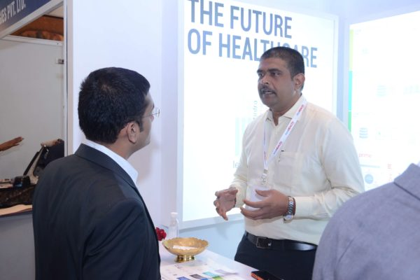 Phani from GalaXe healthcare solutions briefing Dr Saurabh Gupta at InnoHEALTH 2017