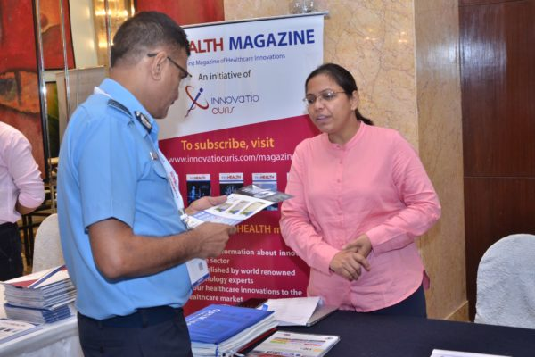 Mamta from Optimaser briefing an attendee at InnoHEALTH 2017