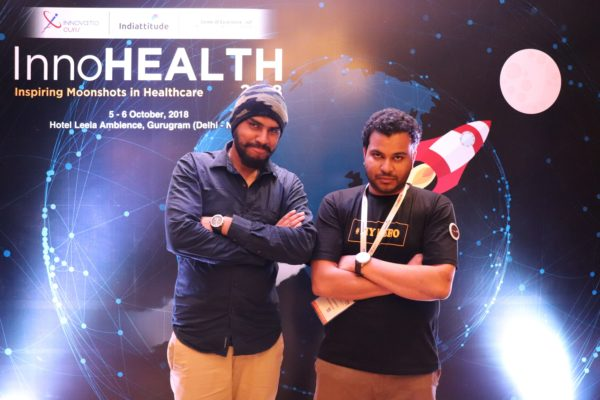 11. (L-R)Dhruv Singh and Clarion Smith pose at the moonshot corner of InnoHEALTH 2018