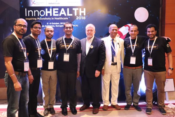 8. (L-R)Alok Chaudhary, Haritash Tamvada, Areez Malik, Saurabh Gupta, Paul Lillrank, Satish Kumar Gupta, Sachin Gaur and Clarion Smith pose at the moonshot corner of InnoHEALTH 2018