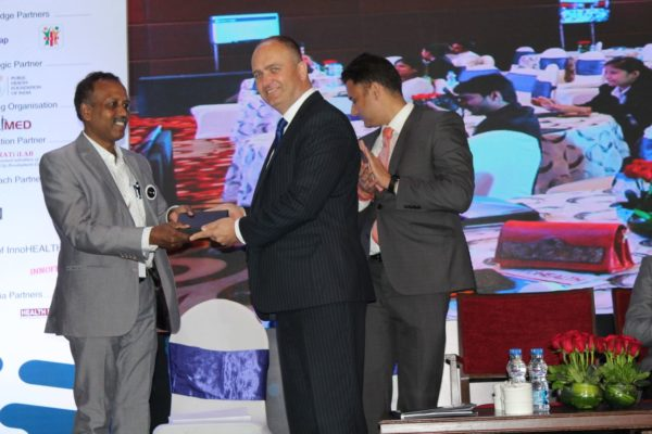 8. Prof S Venkataramanaiah, chairperson for the young innovators award receives a memento from H.E Riho Kruuv at InnoHEALTH 2018