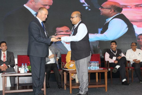 9. Dr Shirshendu Mukherjee receives a memento from H.E Riho Kruuv at InnoHEALTH 2018