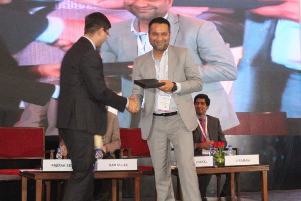 9. Prerak Sethi presents a memento to Bishal Dhakal in session 2 on Achieving universal health coverage, insurance led innovations and AYUSH at InnoHEALTH 2018